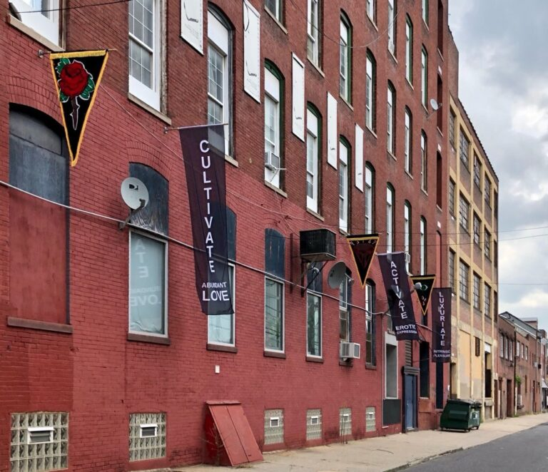 Flags that celebrate 100 year anniversary of Marcus Garvey's Pan-African flag created by artist Heather Raquel Phillips hanging outside the Practice Gallery at 319 11th St. in Philadelphia