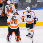 Carter Hart celebrates with captain Claude Giroux