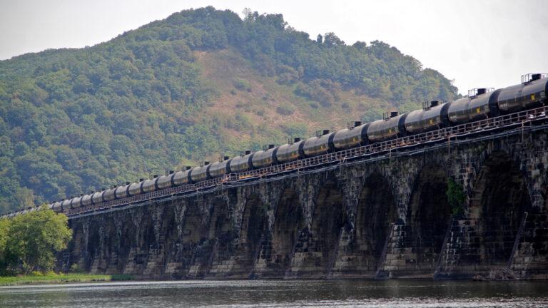 A tanker train crosses the Susquehanna River in Pennsylvania. A proposed new rule that would allow liquefied natural gas to be transported by rail is being challenged because safety and risk assessments have not been done. (Emma Lee/WHYY)