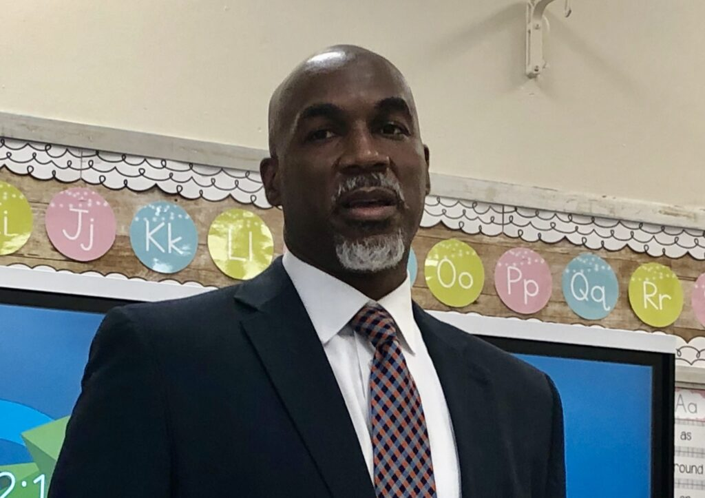 Dorrell Green stands inside a classroom