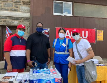 Organizers from several groups outside a church in North Philadelphia for a voter outreach event targeting Puerto Rican residents, immigrants, and formerly incarcerated individuals to give them information on voting rights. (Zachariah Hughes/WHYY)