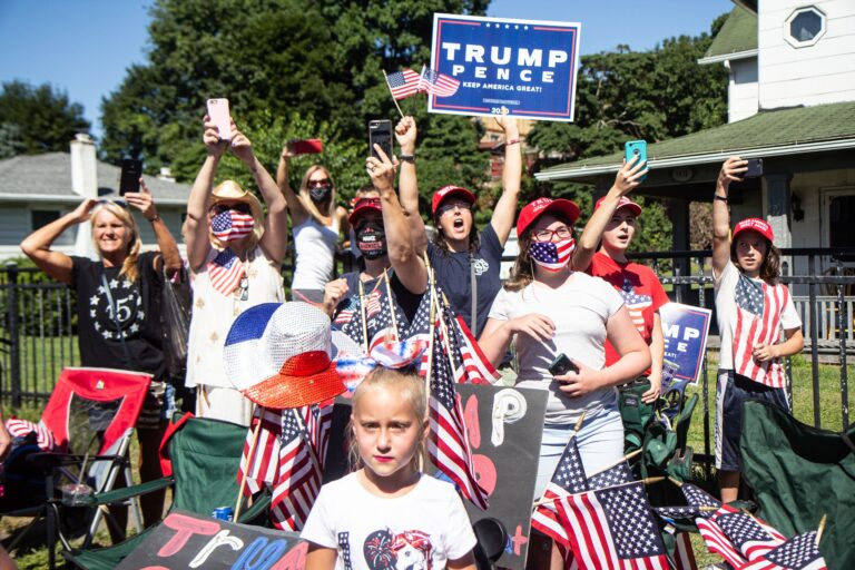 Trump fans excitedly greeted his motorcade as he campaigned in Old Forge, Pa., Thursday. (Kimberly Paynter/WHYY)