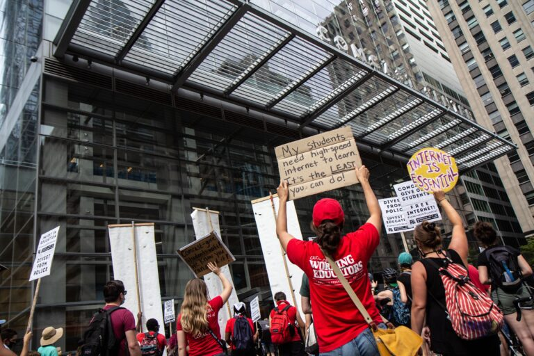 Protesters attempted to deliver a petition to Comcast for free internet for Philadelphia school district students learning virtually on Aug. 3, 2020. (Kimberly Paynter/WHYY)