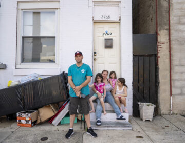 Mike Fallaro and Lisa Swinehart lost work during the pandemic and have been threatened with eviction from their Kensington rowhouse. Two of their three children are scheduled to start school this week. (Jessica Kourkounis for Keystone Crossroads)