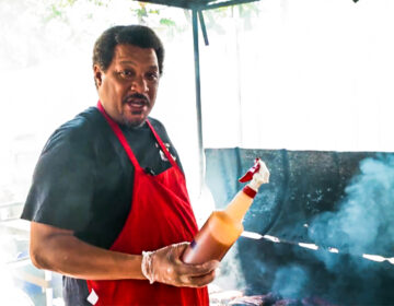 Pitmaster Terrell Barkley cooking at a barbeque