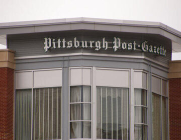 A sign on a building marks the offices of the Pittsburgh Post-Gazette on Thursday, Feb. 14, 2019, in Pittsburgh. The Newspaper Guild of Pittsburgh submitted a charge to the National Labor Relations Board on Wednesday that publisher and editor-in-chief John Robinson Block