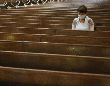 A parishioner sits after Mass last month at a Catholic church in New York City. An overwhelming majority of U.S. adults believe that houses of worship should be subject to the same restrictions on public gatherings that apply to other institutions. (John Minchillo/AP Photo)