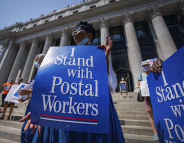 Retired postal worker Glenda Morris protests postal cutbacks on Aug. 25, 2020, in New York. African Americans make up 27 percent of the Postal Service, about twice their share of the overall workforce. (Mark Lennihan/AP)