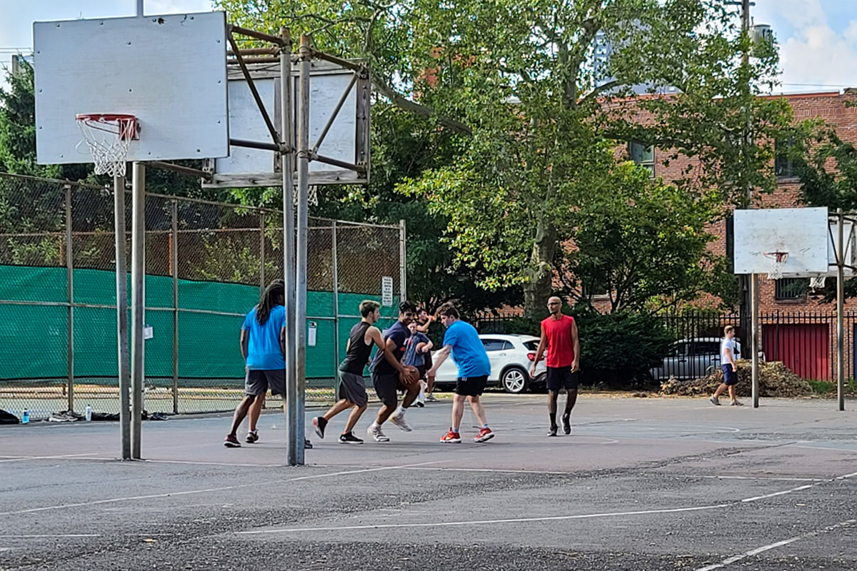 A group of friends plays basketball in South Philadelphia