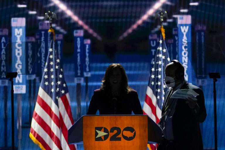 Democratic vice presidential candidate Sen. Kamala Harris, D-Calif., takes her place at the podium to speak before the light go up on stage during the third day of the Democratic National Convention, Wednesday, Aug. 19, 2020, at the Chase Center in Wilmington, Del. (AP Photo/Carolyn Kaster)