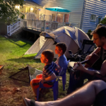 Llama camper Matt Diamondstein plays guitar in Robert Bralows backyard