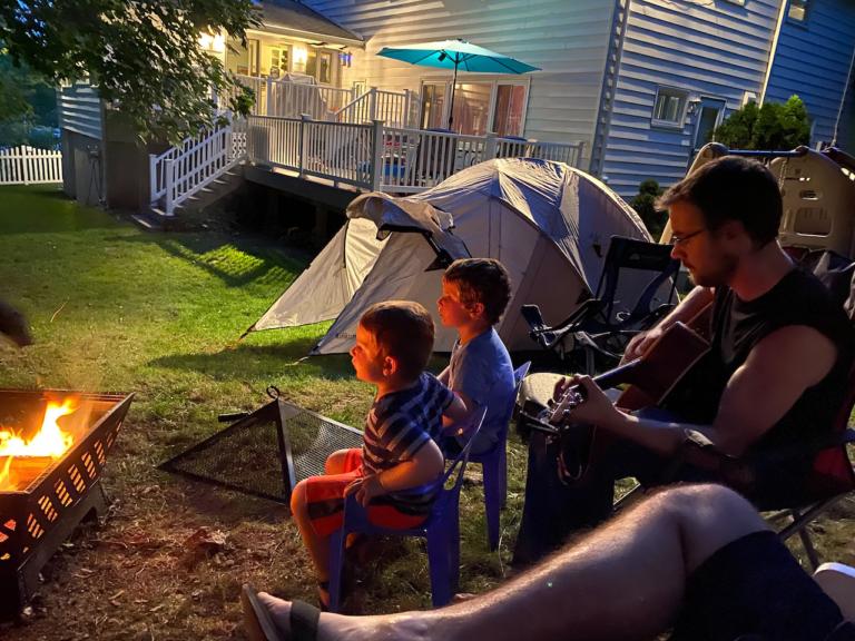 Llama camper Matt Diamondstein plays guitar in Robert Bralows backyard