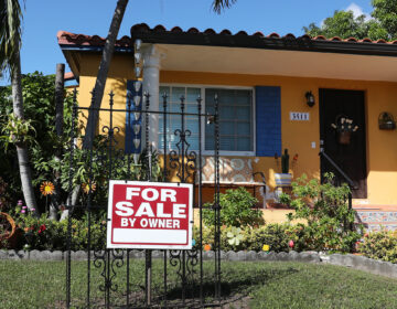 A sale sign is seen in front of a home in Miami. FHA loans are used by many minority, lower-income, and first-time homebuyers because the low down payments make homeownership more affordable. But this demographic is more likely to be hurt financially during the pandemic, and many FHA borrowers are skipping mortgage payments. (Joe Raedle/Getty Images)