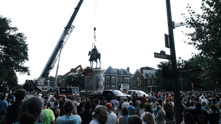 A crowd watches as a crane removes the Stonewall Jackson Monument in Richmond, Va., on July 1. Dozens of Confederate monuments have come down this summer. (Eze Amos/Getty Images)