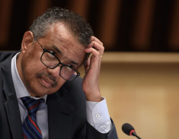 World Health Organization Director-General Tedros Adhanom Ghebreyesus at a news conference last month in Geneva. He is urging countries to join a pact aimed at ensuring access to drugs to prevent COVID-19. (Fabrice  Coffrini/Pool/AFP via Getty Images)