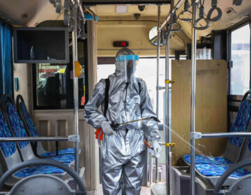 A worker disinfects the inside of a bus in Addis Ababa, Ethiopia. Transit agencies are taking new steps to reduce the risks for riders during the pandemic. (Michael Tewelde/Xinhua News Agency via Getty Images)