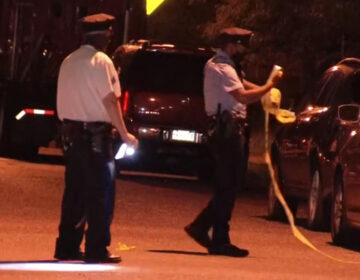Philadelphia police investigate a shooting in Olney