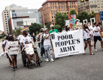 About 50 protesters marched against inequity in Center City Monday.