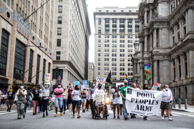 Organizations marching against inequity header to Joe Biden's campaign office