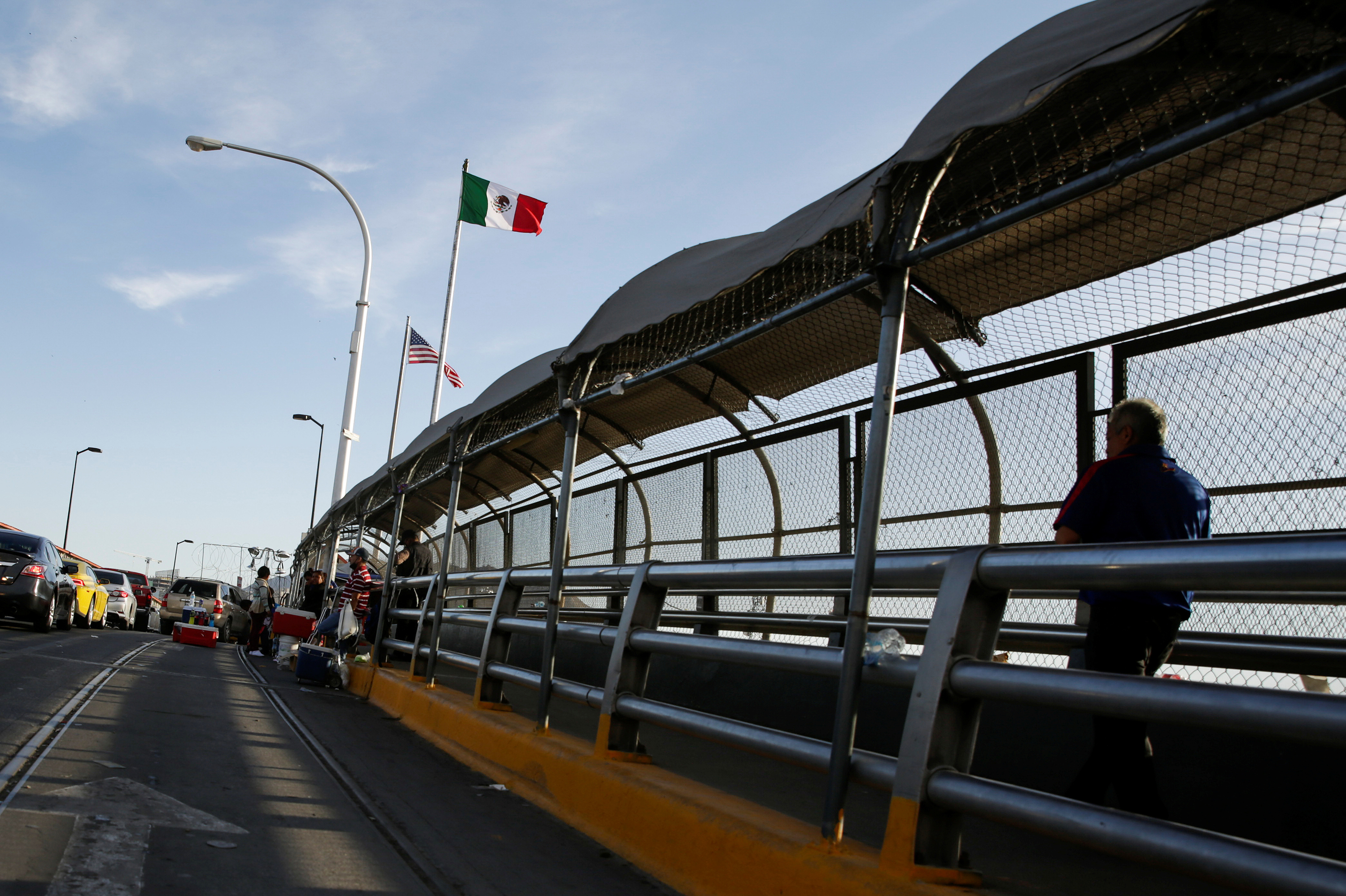 A man crosses the Paso del Norte border bridge towards El Paso, Texas, as seen from Ciudad Juarez, Mexico on July 1. Since March, U.S. immigration officials have turned away tens of thousands of migrants, including asylum seekers and unaccompanied children.
