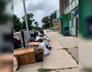 Flood damage from Tropical Storm Isaias and piles of garbage that have gone uncollected for days or weeks as Upper Darby scrambles to deal with twin crises of a weather disaster and coronavirus cluster among sanitation workers. (Photos via Chuck Nguyen)
