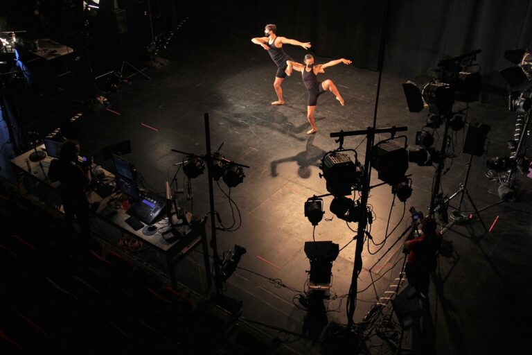 View of dancers in the spotlight on stage from above