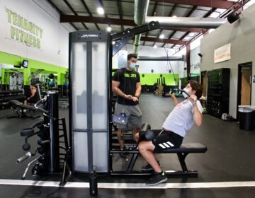Mason Merrill of Westampton (right), works out with trainer Angelo Prince at Tenacity Fitness in Hainesport, N.J. (Emma Lee/WHYY)