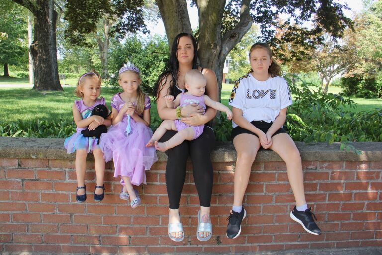 As a single mother of four, Tiffani Szabara is finding virtual school challenging for her two oldest daughters. They are (from left) Brinley, 4, first grader Cadence, 6, Emmarie, 1, and 7th grader Jaedlyn, 12. (Emma Lee/WHYY)