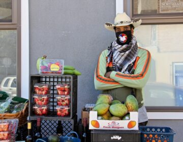 Derwood Selby opened an outdoor market on Parrish Street near Corinthian Avenue in the Francisville section of Philadelphia, selling fresh produce and his signature olive oils and balsamic vinaigrettes.(Emma Lee/WHYY)
