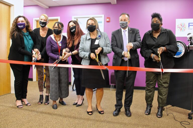 Burlington County officials, including (from right) County Commissioner Director Felicia Hopson and Prosecutor Scott Coffina, cut the ribbon to open the county's new addiction Recovery Center in Westampton, N.J.. (Emma Lee/WHYY)