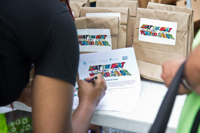 Hunting Park residents were asked to fill out a heat survey at a food pick-up at the Lenfest Center