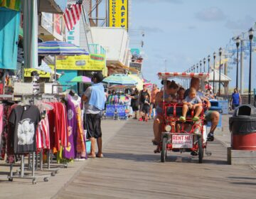 People ride bikes on the boardwalk