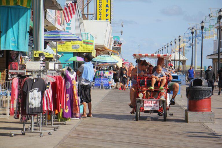 People ride bikes on the boardwalk