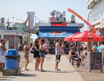 People line up outside a restaurant on the Seaside Heights boardwalk