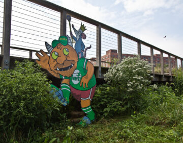 A troll by artist Kid Hazo under a footbridge at Philadelphia's Navy Yard. (Kimberly Paynter/WHYY)