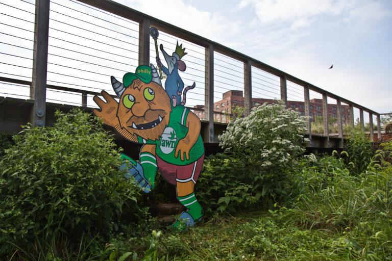 A troll by artist Kid Hazo under a footbridge at Philadelphia's Navy Yard. (Kimberly Paynter/WHYY)