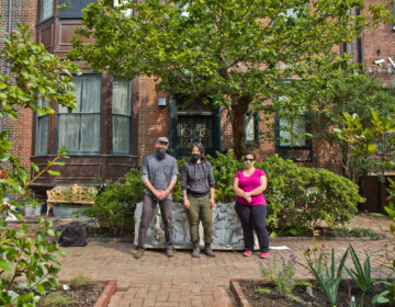 Steve Bartholomew (left), Rosenbach Museum visitor services staff, Christina Doe (center), facilities manager, and Emilie Parker (right), director of education, at the Rosenbach's garden. (Kimberly Paynter/WHYY)