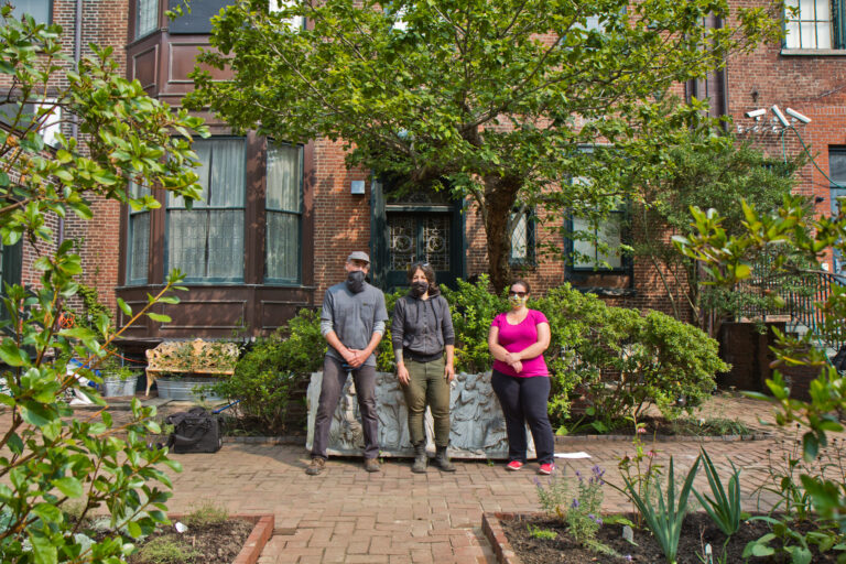 Members of the Rosenbach staff standing in front of the Rosenbach's garden