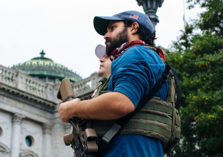 An attendee holds his weapon at the Rally to Protect Your Right to Keep and Bear Arms at the state Capitol on September 29, 2020. (Kate Landis/WITF)