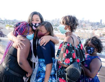 Lady B embraces students after seeing her biography for the first time. (Sandrien B Photography)