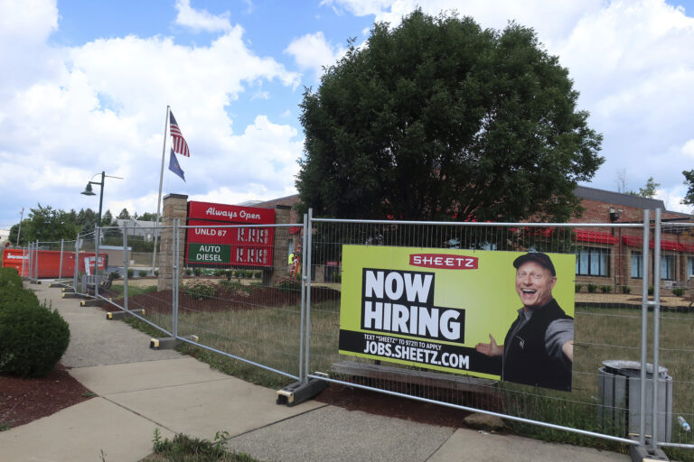 A 'Now Hiring' sign hangs in front of a Sheetz convenience store and gas station under construction on Tuesday, August 18, 2020 in Wexford, Pennsylvania. (AP Photo/Ted Shaffrey)