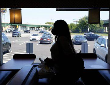 A customer walks through the Penrose Diner after eating indoors during the coronavirus, Tuesday, Sept. 8, 2020, in Philadelphia. (Matt Slocum / AP Photo)