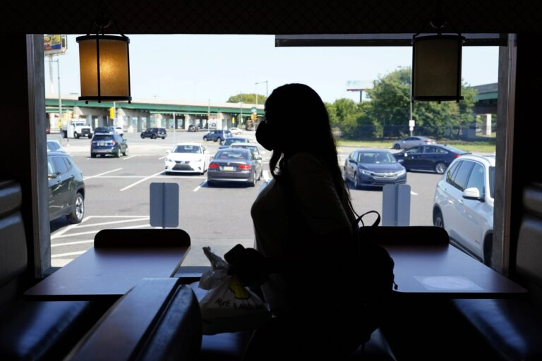 A customer walks through the Penrose Diner after eating indoors during the coronavirus, Tuesday, Sept. 8, 2020, in Philadelphia. (Matt Slocum / AP Photo)
