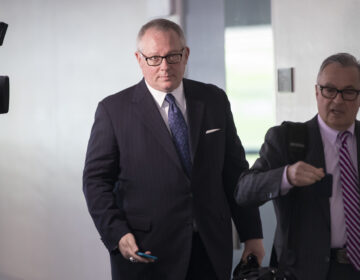 Former Trump Campaign official Michael Caputo, center, joined by his attorney Dennis C. Vacco, right, leaves after a three-hour interview by Senate Intelligence Committee staff that is investigating Russian meddling in the 2016 presidential election, on Capitol Hill in Washington, Tuesday, May 1, 2018. (AP Photo/J. Scott Applewhite)