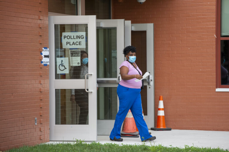 Voters head to the polls at Claymont Elementary in Claymont, Del., Tuesday, Sept. 15, 2020. (AP Photo/Jason Minto)