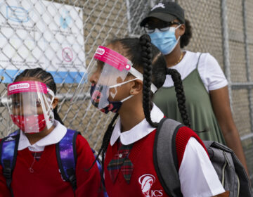 In this Sept. 9, 2020 photo, students wear protective masks as they arrive for classes at the Immaculate Conception School while observing COVID-19 prevention protocols in The Bronx borough of New York. (AP Photo/John Minchillo)