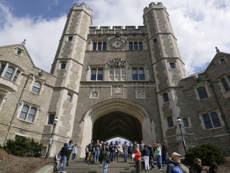 In this April 5, 2018, file photo, people walk through the Princeton University campus in Princeton, N.J. (AP Photo/Seth Wenig)