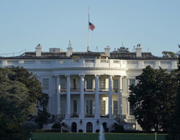 An American flag flies at half-staff over the White House in Washington, Saturday, Sept. 19, 2020. (AP Photo/Patrick Semansky)
