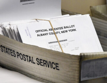 Box of absentee ballots waiting to be counted at the Albany County Board of Elections, Tuesday, June 30, 2020, in Albany, N.Y. (AP Photo/Hans Pennink)