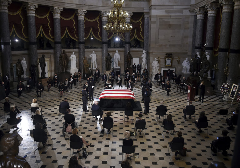 A U.S. Capitol Police honor guard surrounds the flag-draped casket of Justice Ruth Bader Ginsburg as lies in state in Statuary Hall of the U.S. Capitol, Friday, Sept. 25, 2020 in Washington. (Olivier Douliery/Pool via AP)